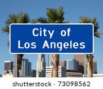 Los Angeles city limit sign with towers and Palm Trees. - stock photo