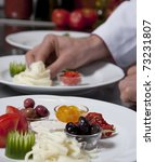 Chef decorating a plate in the kitchen - stock photo