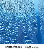 large and fine water drops on glass - stock photo