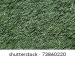 Green background of artificial plastic grass - stock photo