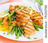 grilled salmon with asparagus on white plate, soft focus - stock photo
