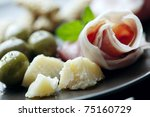 plate of italian foods like parma ham and parmesan cheese - stock photo
