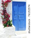 Old door and flowers on Santorini island, Greece - stock photo