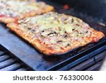 Pizza on the grill - stock photo