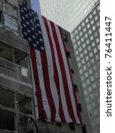 Large US Flag on building across from Ground Zero WTC taken on 9-18-2001  (left of WFC fallen atrium glass dome) - stock photo