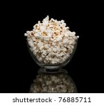 Popcorn in a glass pot , isolated on black background - stock photo