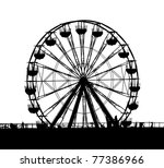 A ferris wheel at a local fun fair seen in silhouette - stock photo