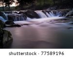 River landscape with a little waterfall - stock photo