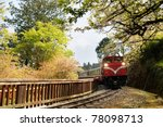 Forest train on railway with sakura in Alishan National Scenic Area, Taiwan, Asia. - stock photo