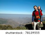 Mountain trekking with Dad - stock photo