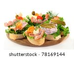 different colored Canapes on a white background - stock photo