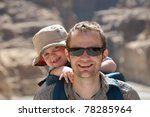 Father and son traveling together outdoors - stock photo