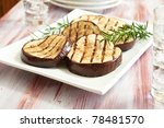 Platter of grilled eggplant with rosemary - stock photo