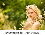 Young girl and  flowers in her hair - stock photo