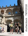 SANTIAGO DE COMPOSTELA, SPAIN - MAY 30: Pilgrims on the Camino de Santiago in the door Platerias after reaching Santiago de Compostela on May 30, 2009, in Santiago, Spain. Xacobeo year. - stock photo