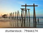 Old Wooden Amusement Pier beams at dusk on Ocean City Beach Atlantic Ocean - stock photo