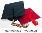 Black and red graduation caps with tassels on the white background. - stock photo