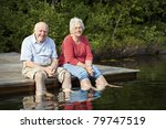 Senior couple enjoying a day at the lake - stock photo