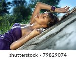 fashionable sexual woman lies concrete - stock photo
