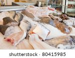 An array of fresh fish sits on display in a fishmongers counter - stock photo