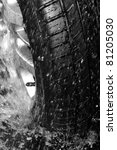 Close up wet tire - stock photo