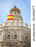 Torre De Oro in Sevilla with flag of Spain - stock photo