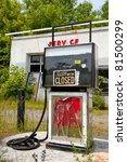 Abandoned service station with smashed glass and closed sign.  A sign of the times. - stock photo