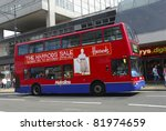 LONDON -JULY 16 : A Double decker red bus is shown along Oxford Street on July 16, 2006 in London. According to Bloomberg, there are approximately 548 shops here and it is Europe's busiest shopping street. - stock photo