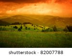 orange mist over mountains and cloudy sky - stock photo