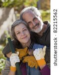 Portrait of a senior couple doing yard work - stock photo