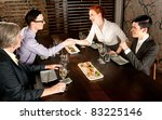 Four people people meeting for lunch - stock photo