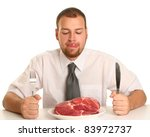 eccentric guy eating red meat - stock photo