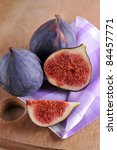slice fig on wood background - stock photo
