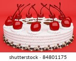 I love you: cake with cherries on red background - stock photo