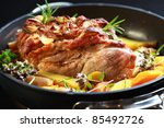 Tasty roasted pork meat with western potatoes and vegetable - stock photo