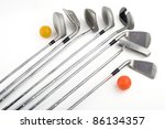 eight golf clubs with two balls on a white background - stock photo