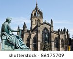 St. Giles Cathedral (High Kirk of Edinburgh) with David Hume Statue in foreground on Royal Mile in Edinburgh, Scotland - stock photo