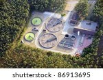 Modern plant building and trickling filters for waste-water treatment - stock photo