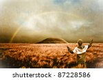 Landscape with rainbow and boy - spiritual scene, retro look image - stock photo