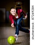 a young woman playing bowling - stock photo