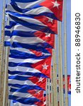 Row of Cuban flags flying in the wind - stock photo