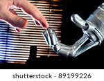 Contact between human and robot - stock photo