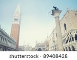 St Mark's Campanile, Sculpture of the winged lion, the Doges Palace and the St Mark's Basilica at St Mark`s Square in Venice on a foggy day. - stock photo