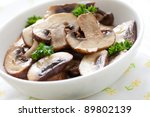 fresh fried mushrooms with parsley - stock photo
