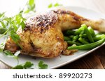 closeup of roast chicken and oven potatoes - stock photo