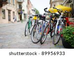 Row of parked colorful bikes on a street - stock photo