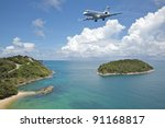Private jet plane is going to land at the airport of a tropical island. Luxury style living concept. - stock photo