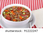 Beef and vegetable soup in a white bowl - stock photo