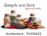 still life of different spices and herbs isolated on white background - stock photo