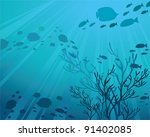 Silhouettes of fish and sun rays in a sea - stock vector